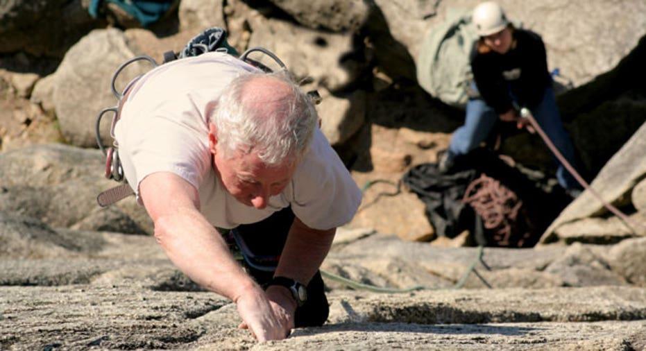 Elderly Man Rock Climbing