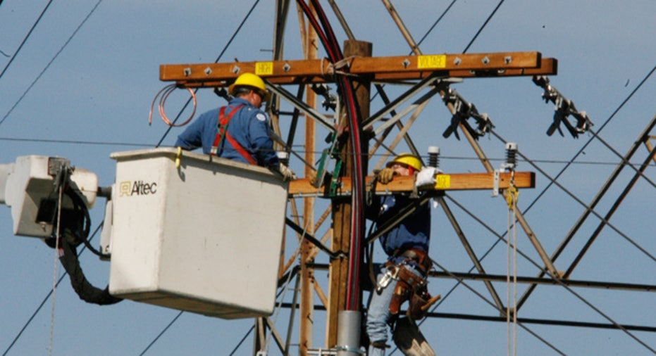 Man Works on Electric Pole