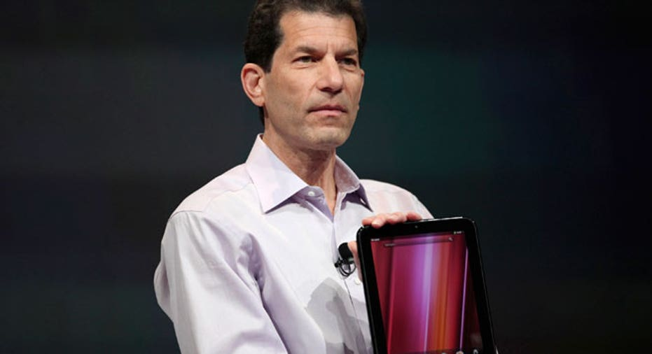 HP Palm Jon Rubinstein Holding TouchPad