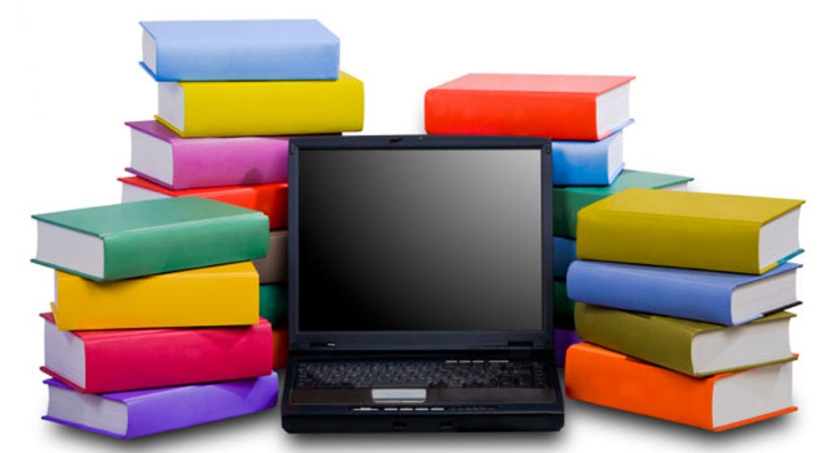 Laptop With Books Stacked Behind