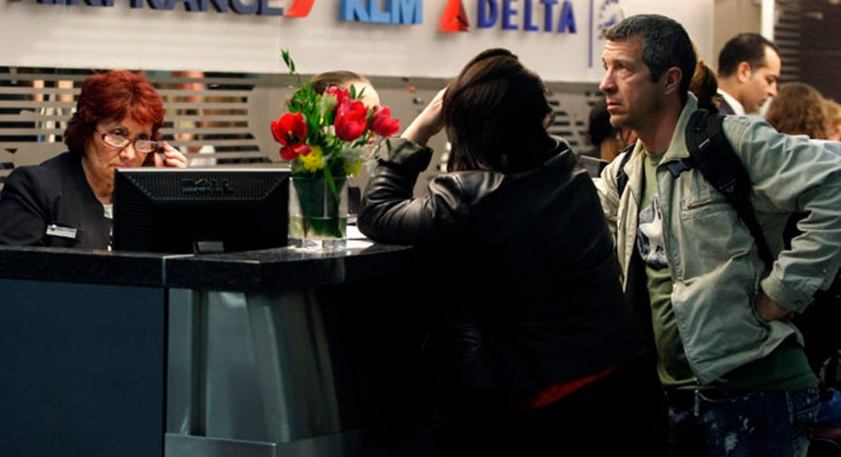 People checking in at airport