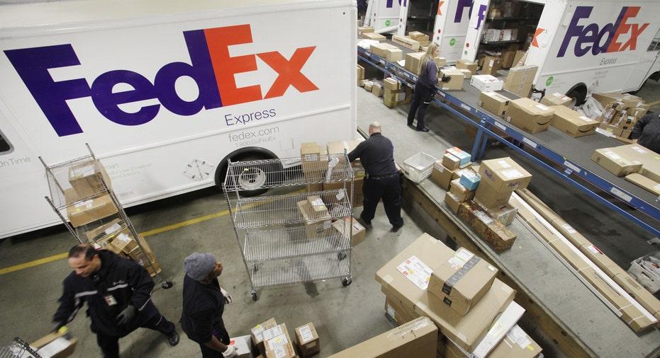 FedEx trucks loading FBN