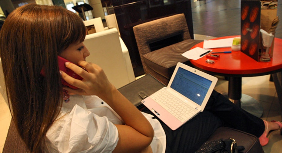 Netbook Laptop Computer Woman on Phone at Cafe FBN
