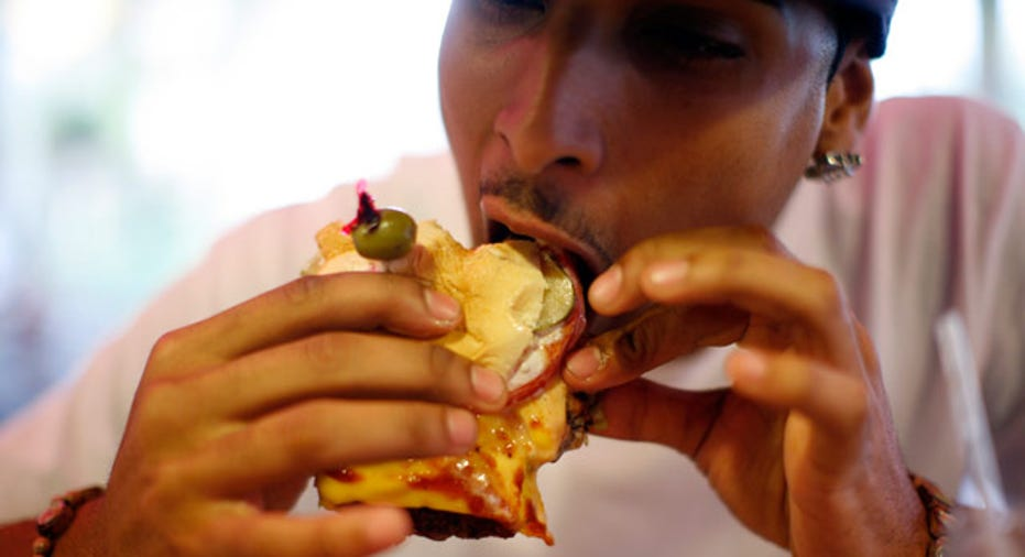 Food Portion Eating a Burger Reuters