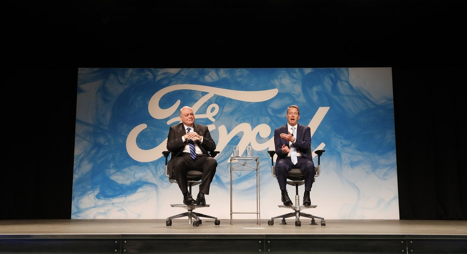 Ford CEO Jim Hackett on stage with Bill Ford FBN