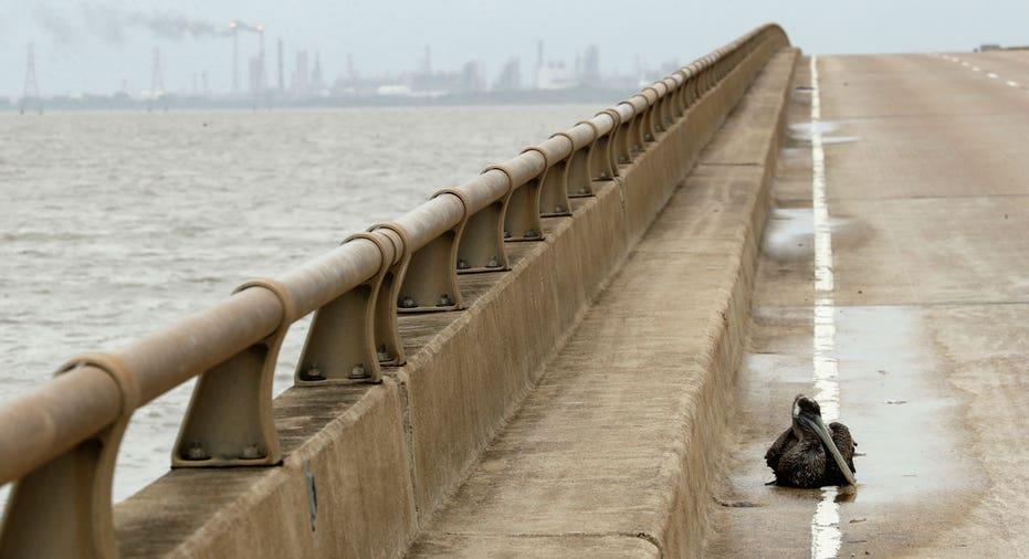 Hurricane Harvey bridge with refinery in background AP FBN