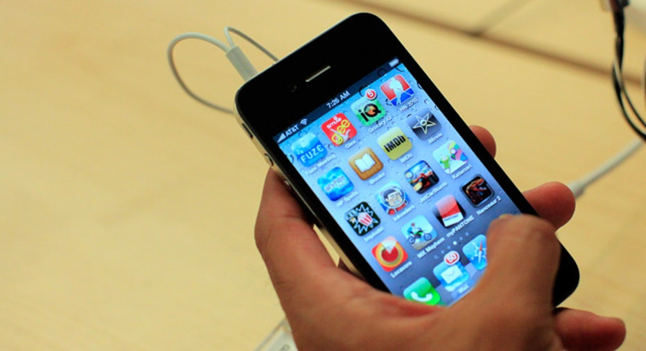 iPhone 4 in Hand Showing Apps