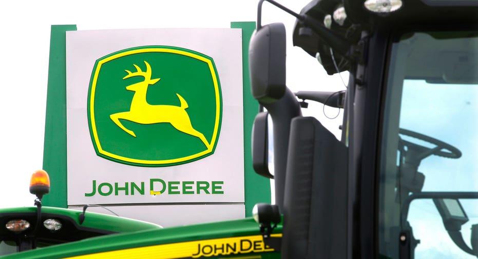 John Deere tractor and dealer sign FBN