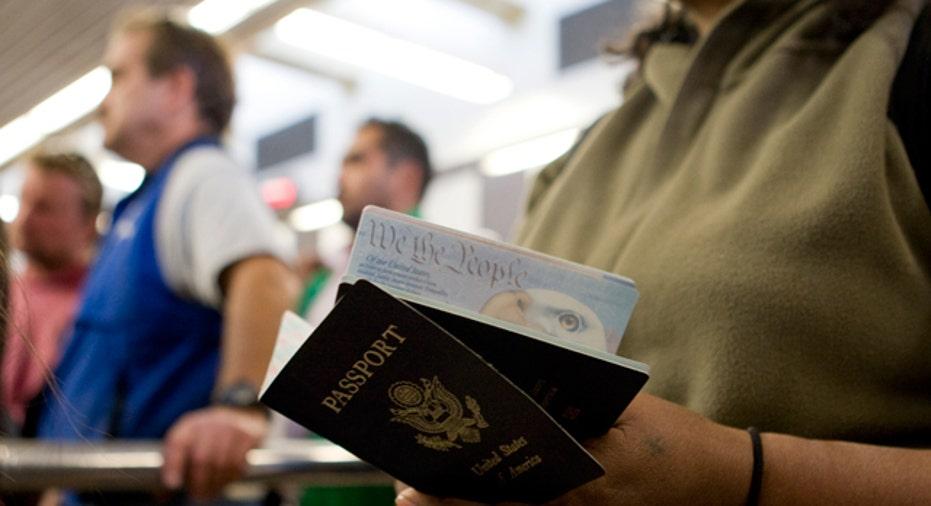 Woman Holds Passports, Reuters
