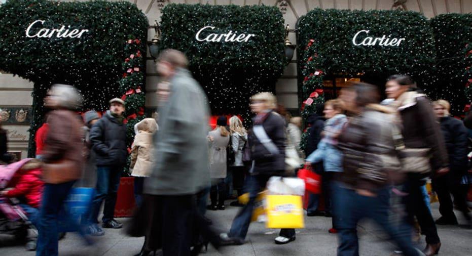 Shoppers in Fifth Avenue Cartier, Reuters