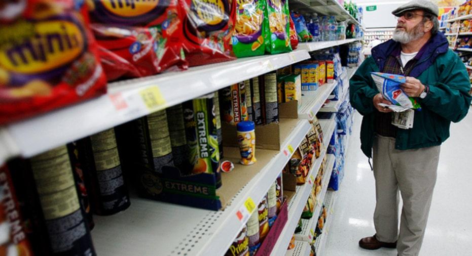 Older Man Grocery Shopping for Snacks