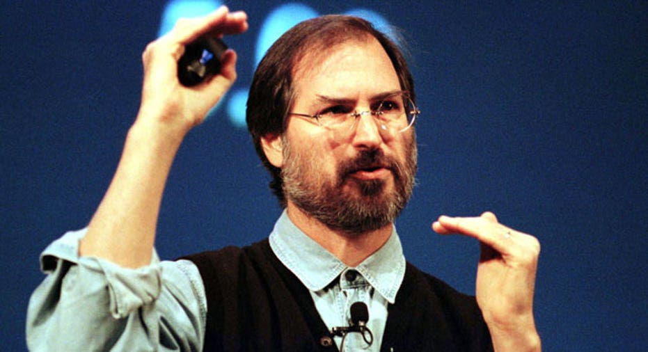 Steve Jobs talks during a presentation, 1997, Reuters