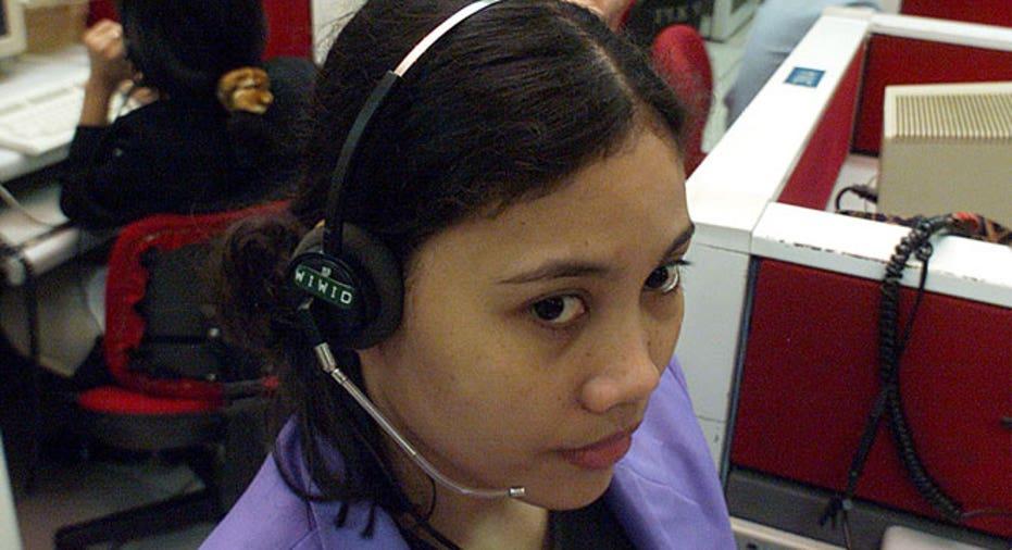 telephone operator, switchboard operator, operator