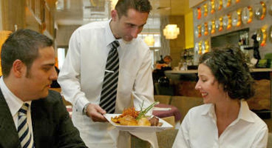 Waiter at Restaurant Serving