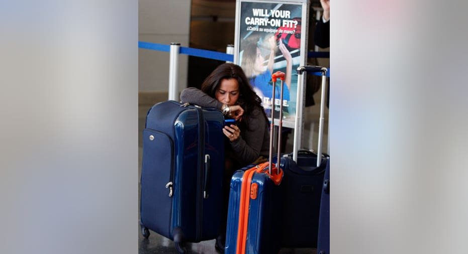 Vertical Photo of a Woman at JFK Airport Reuters