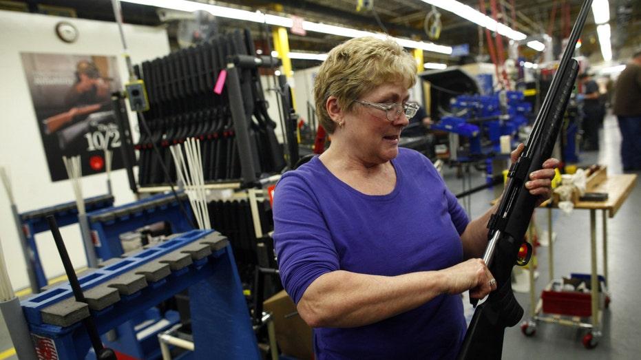Ruger worker assembling rifle FBN