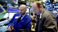 Stock futures trade lower after day of losses