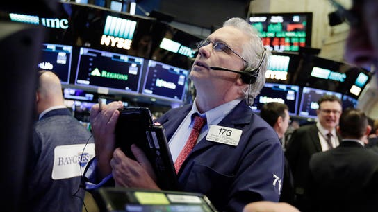 Dow surges more than 500 points on positive earnings