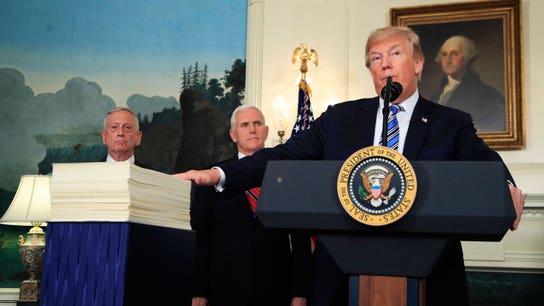 Trump backs $1.3T spending bill after veto threat