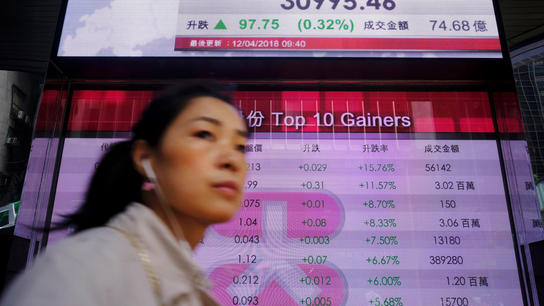 Asian shares mixed as markets mull Fed, geopolitical risk
