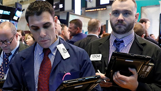 Dow loses 287 points as stocks slammed by escalating trade conflict