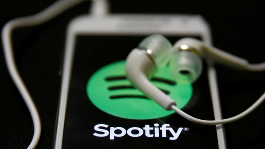 Spotify IPO pops over 25% on trading debut