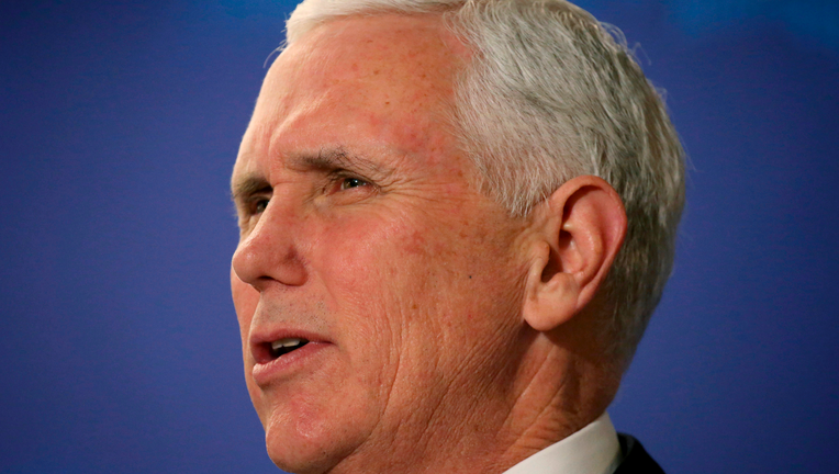 Pence to press hard line on Venezuela, promote U.S. trade