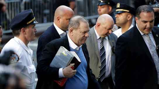 The Latest: Weinstein takes books on theater, film to arrest