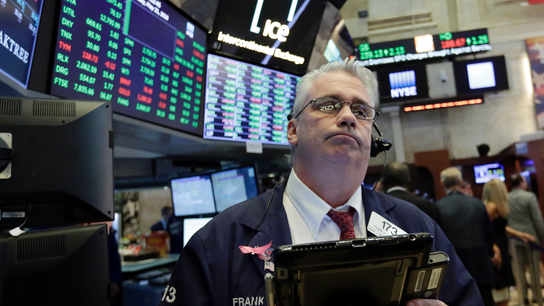 Asian markets mostly lower after Wall Street gains