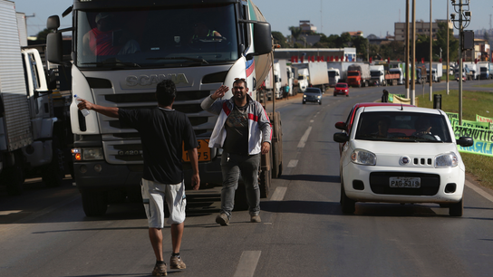 Empty stores, shuttered gas posts in Brazil truckers' strike