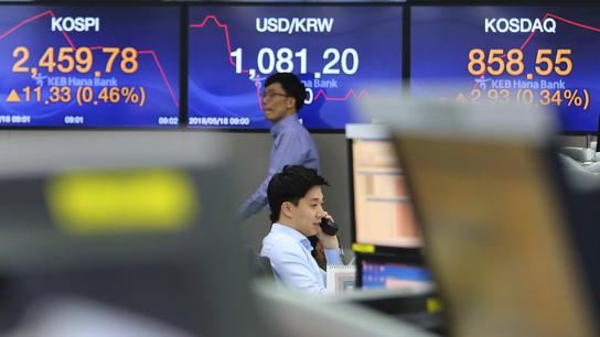 Global stocks mixed on backdrop of US-China talks