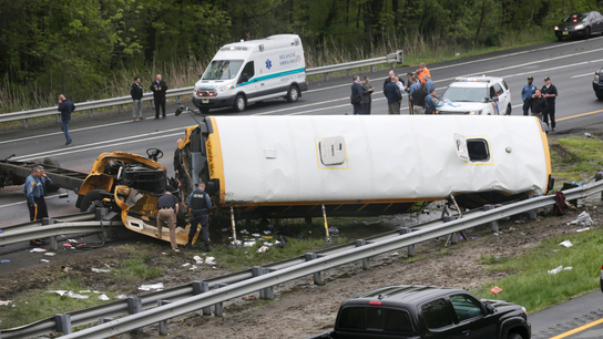 School bus torn apart in dump truck collision, killing 2