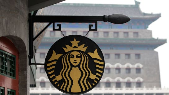 Another Starbucks executive retires, shares fall to multiyear low