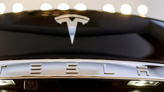 Tesla to shell out cash for big $920M bond payment