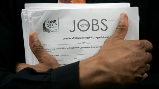US weekly jobless claims near 49-year low; import prices fall