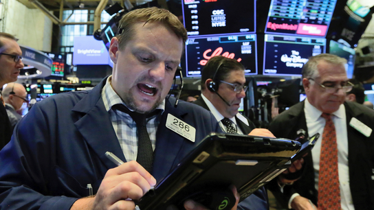 Stocks emerge from wild, unpredictable first half with gains