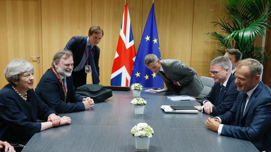 The Latest: Merkel calls UK's residency stance 'good start'