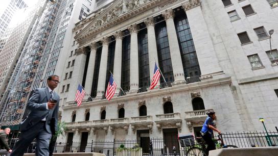 Stocks waver, dollar slips as traders shrug off trade talk