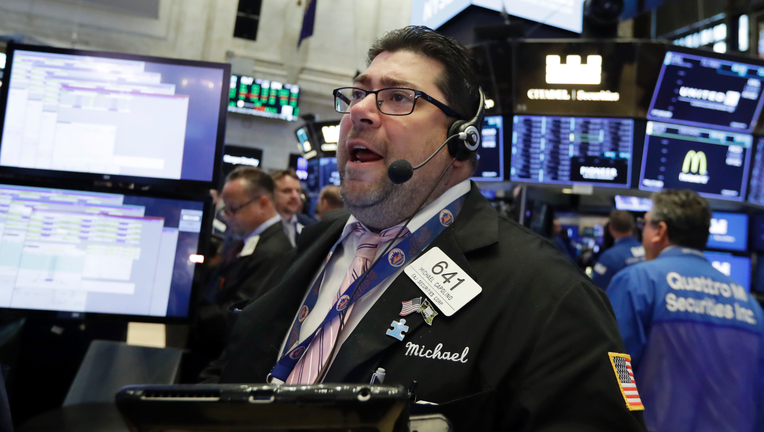 Wall Street gains; investors expect strong earnings