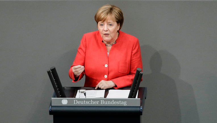 Merkel ready to back lower European Union  tariffs on U.S.  cars