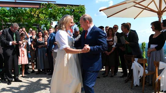 Putin dances at Austria wedding before meeting Merkel