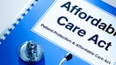 Obamacare insurance premiums drop slightly