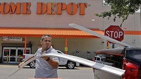 Home Depot drags Dow down in mixed market