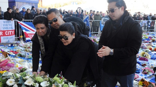 The Latest: Leicester players visit memorial to Thai owner