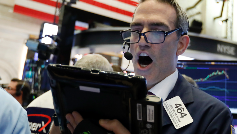 Stocks slump again, putting S&P 500 back into red for year