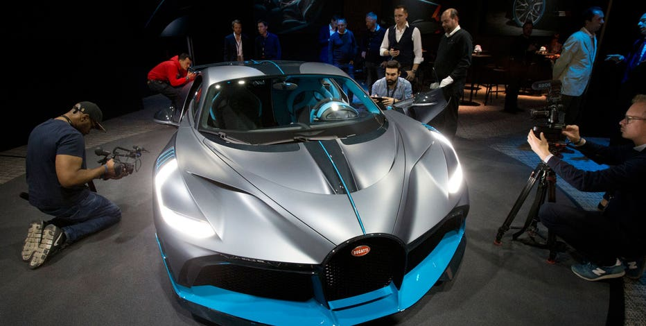Paris Motor Show Ferrari Bmw And Bugatti Bring New Sports Cars