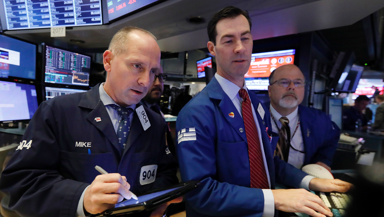 Stock market skid intensifies, erasing 2018 gains for Dow, S&P 500