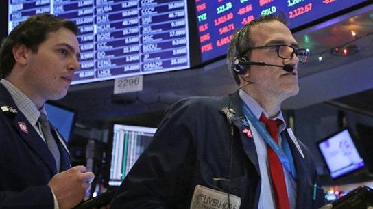Stocks slightly down on retail earnings, strong economic data