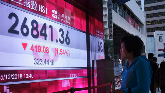 Asian shares skid as Huawei CFO arrest revives trade jitters