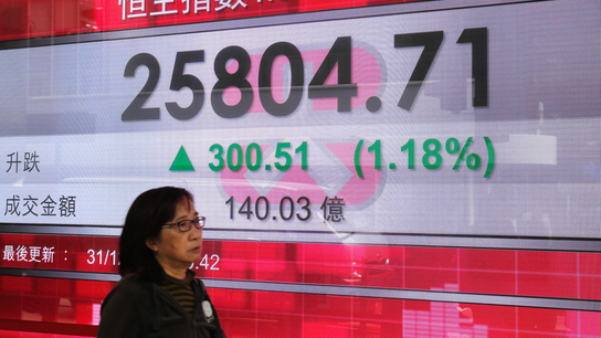 World stocks rise on last day of turbulent year